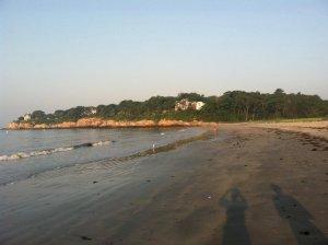 our shadows cast on the beach as the sun rises. bliss.